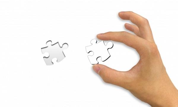 仕組み・システムを暗示するジグソーパズル